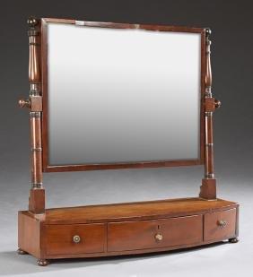 English Carved Mahogany Shaving Mirror, 19th c., the
