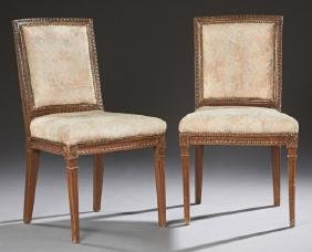 Pair of French Louis XVI Style Carved Walnut