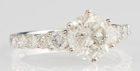 Lady's 18K White Gold Dinner Ring, with a central 1.72