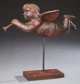 Carved Wood Flying Angel, 20th c., with trumpet,