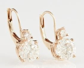 Pair of Diamond Hoop Pierced Earrings, each with a