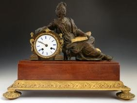French Patinated and Gilt Bronze Mantle Clock, 19th c.,