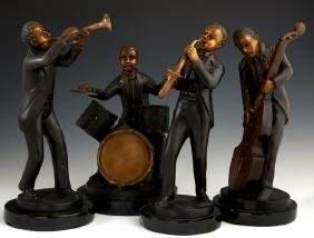 Group of Four Patinated Bronze Figures of Jazz