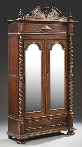 French Henri II Style Carved Walnut Armoire, late 19th