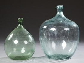 Two Pale Green Mold Blown Glass Wine Carboys, 19th c.,