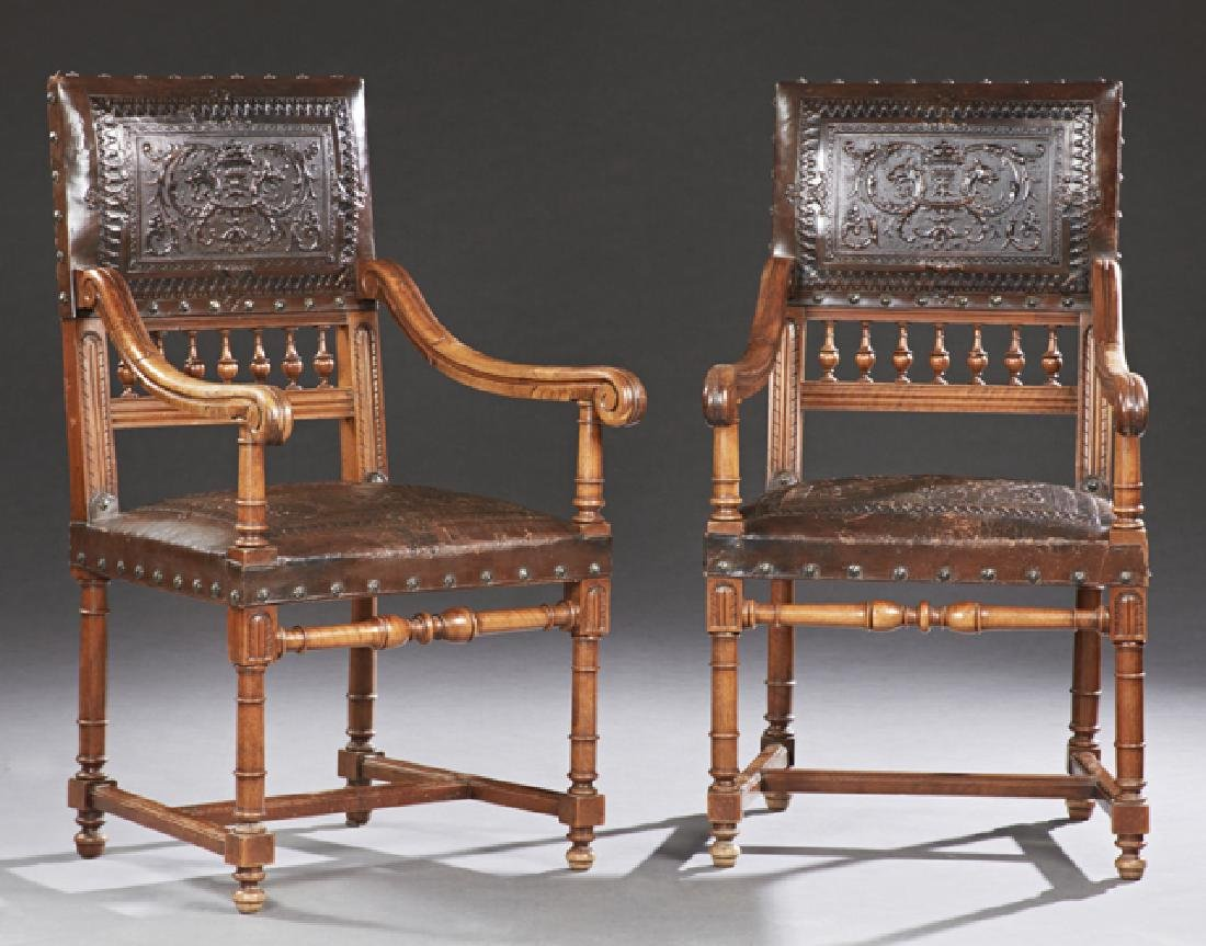 Pair of Spanish Style Carved Walnut and Leather