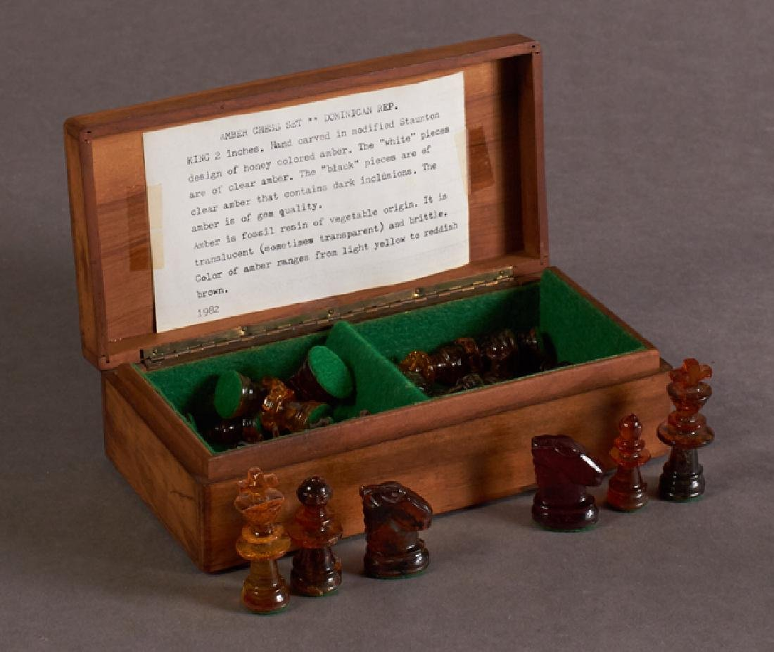 Diminutive Carved Amber Chess Set, 20th c., Dominican