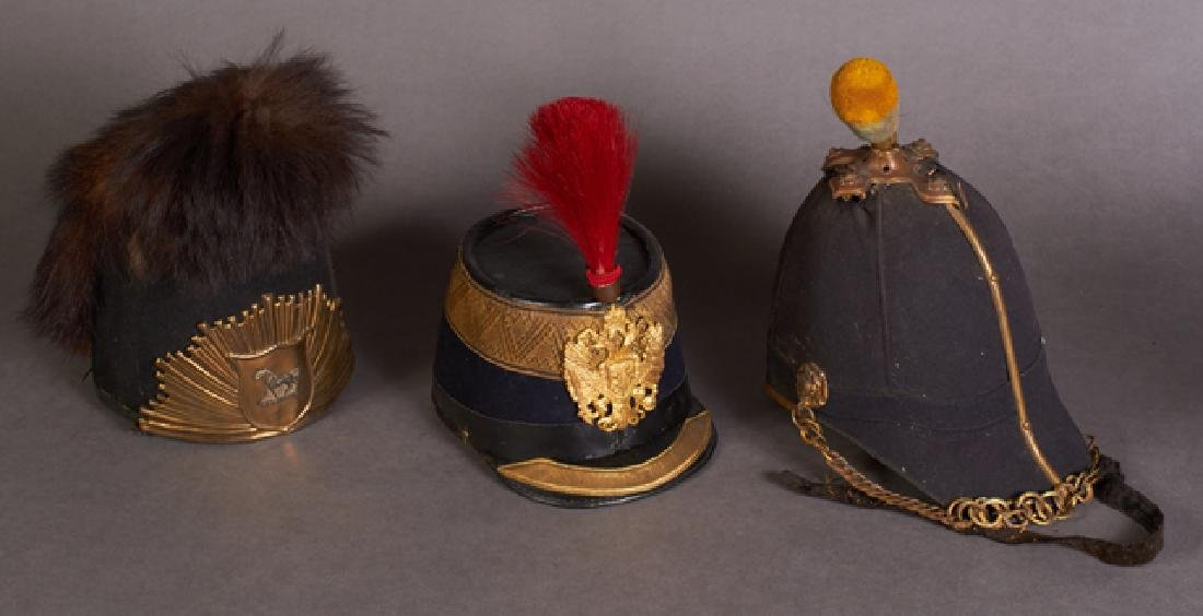 Three Vintage Helmets, c. 1900, consisting of an