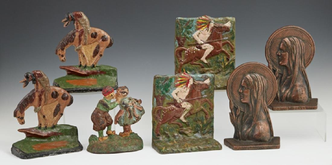 Group of Seven Cast Iron Bookends, early 20th c.,
