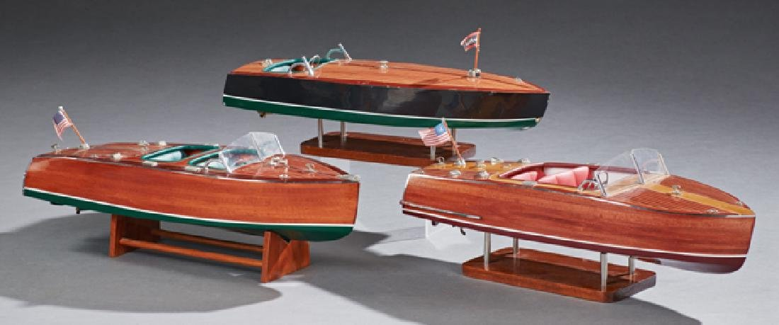 Group of Three Carved Mahogany Model Boats, 20th c., on