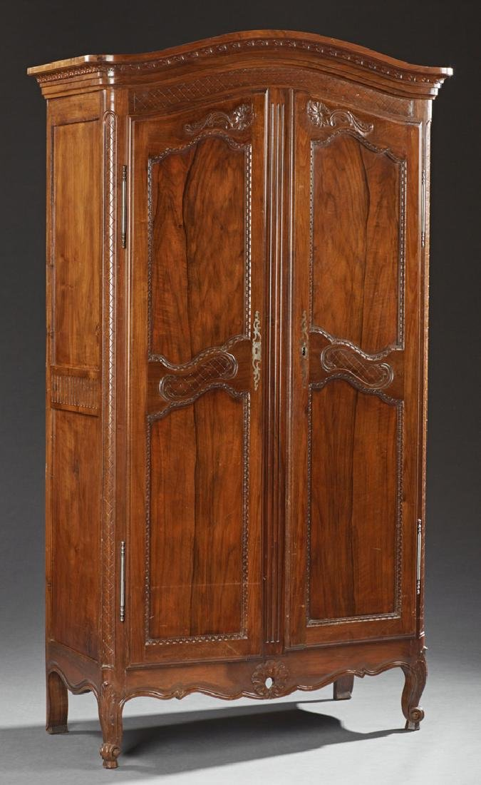 Diminutive French Carved Walnut Armoire, 19th c., the
