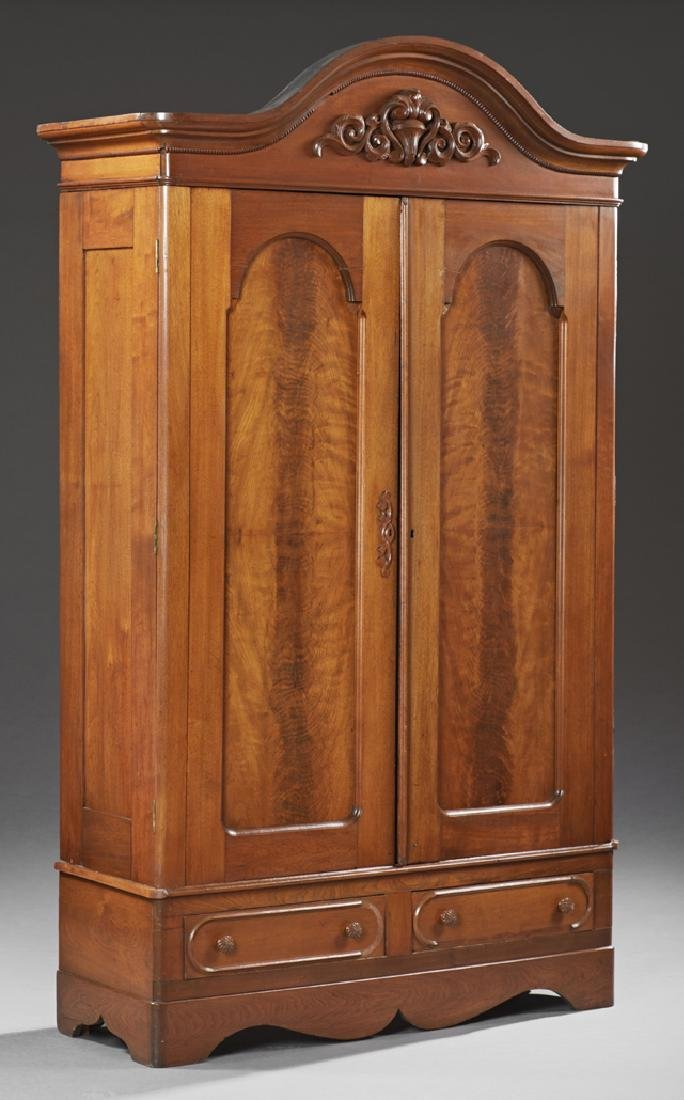 American Victorian Carved Walnut Armoire, 19th c., the