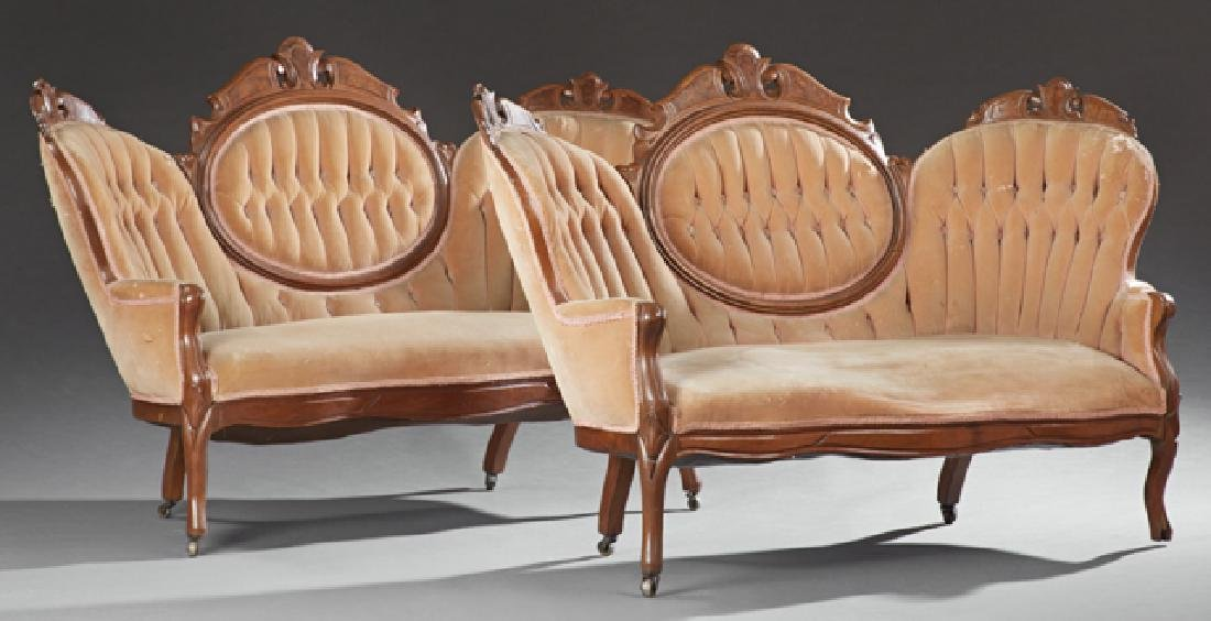 Pair of Victorian Carved Walnut Triple Back Settees,