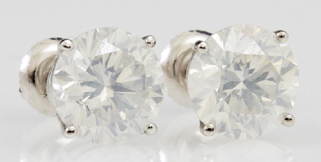 Pair of 14K White Gold Diamond Stud Earrings, each with