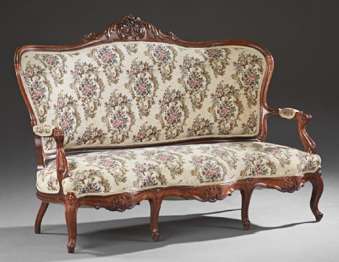 American Carved Walnut Sofa, 19th c., the arched curved