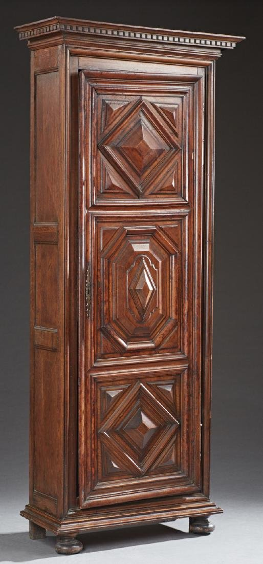 French Carved Oak Bonnetiere, 19th c., the ogee stepped