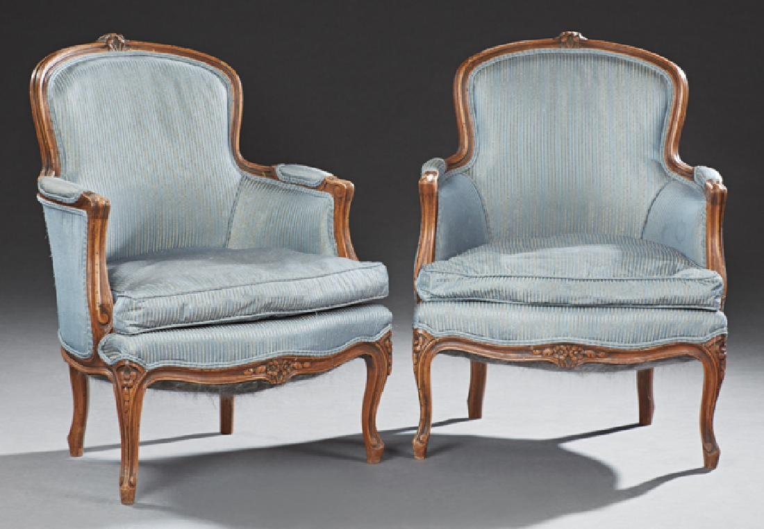 Pair of French Carved Bergeres, 20th c., the floral