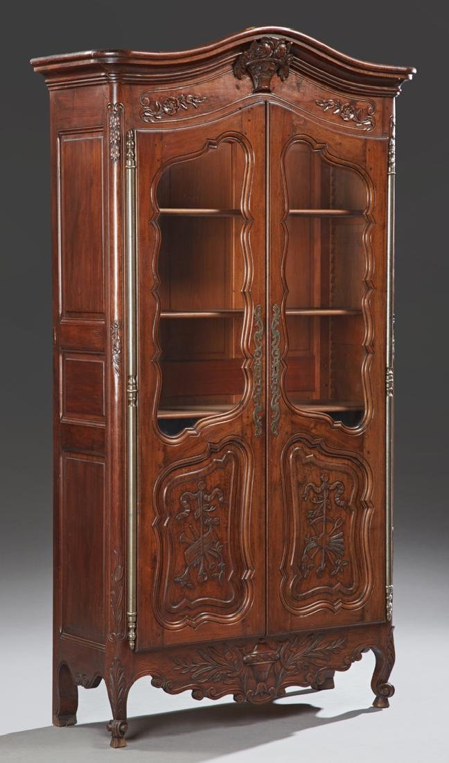 Louis XV Style Carved Walnut Bookcase, 19th c., the