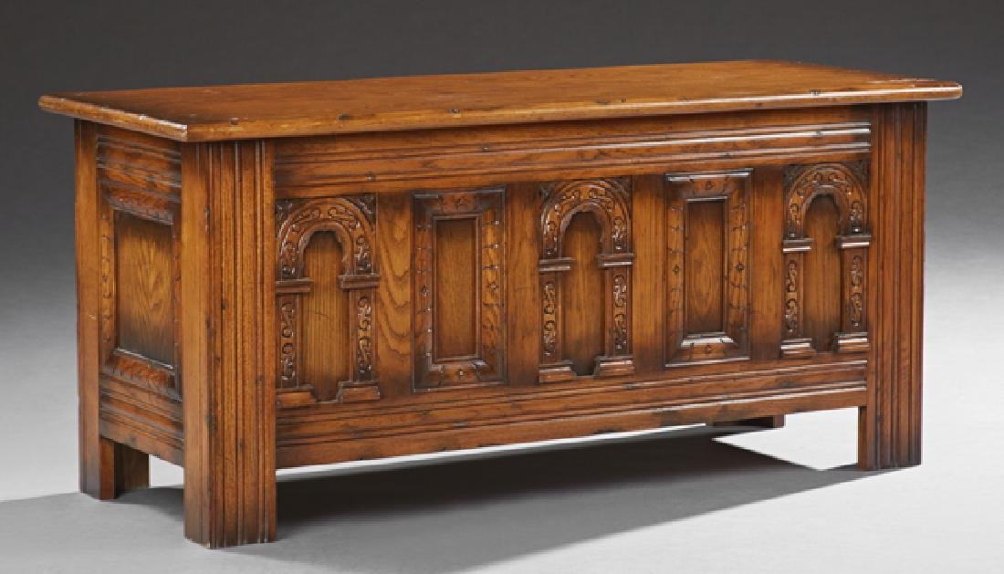 English Style Carved Oak Bedding Box, 20th c., with an