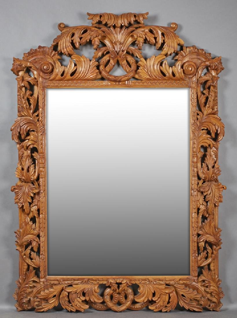 Heavily Carved Mahogany Overmantle Mirror, 20th c., the