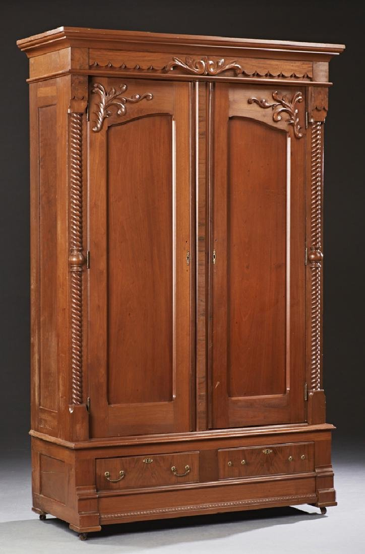 American Eastlake Carved Walnut Armoire, c. 1890, the