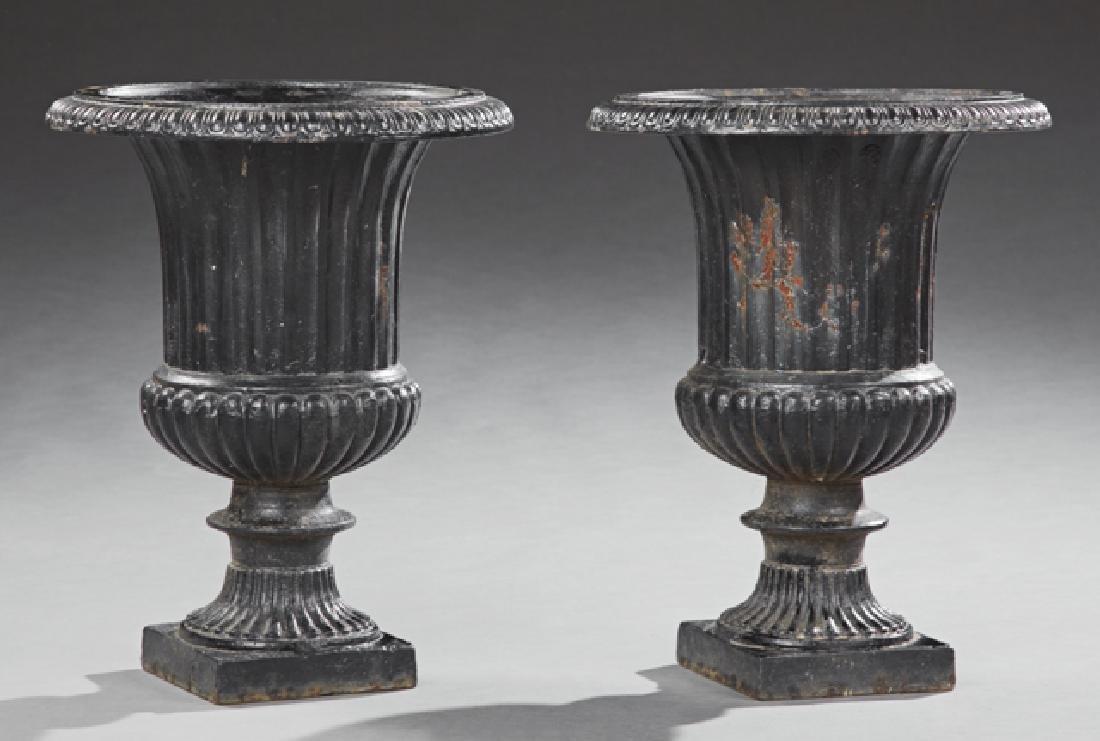 Pair of Cast Iron Campana Form Garden Urns, 20th c.,