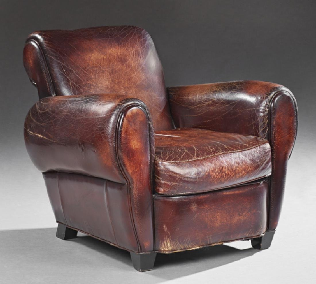 Leather Club Chair, 20th c., with rolled arms and back,