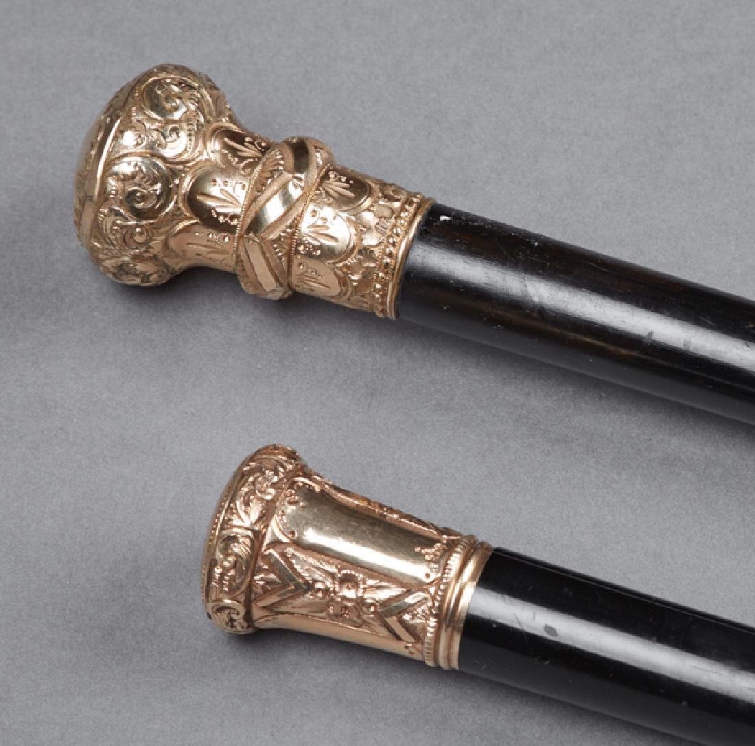 Two Ebonized Canes, 19th c., with gold plated knob