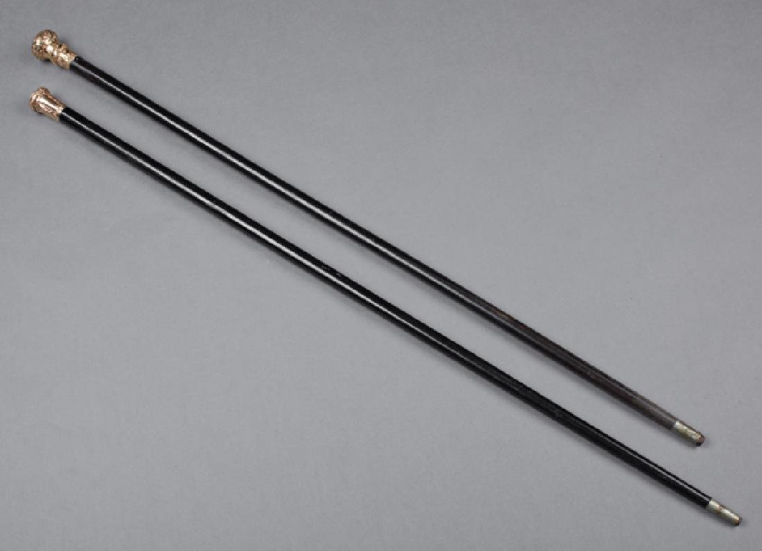 Two Ebonized Canes, 19th c., with gold plated knob - 2