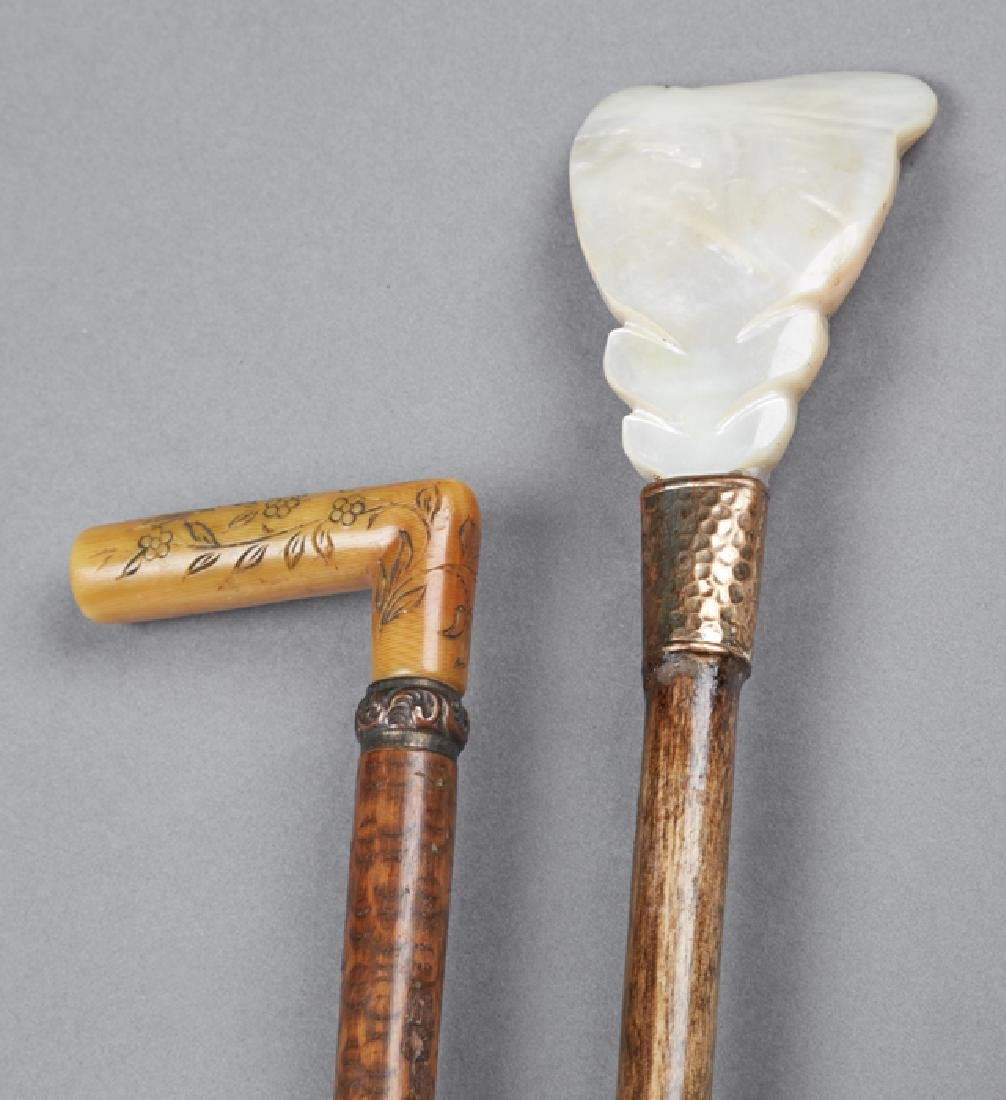 Group of Two Canes, early 20th c., one of bamboo with a