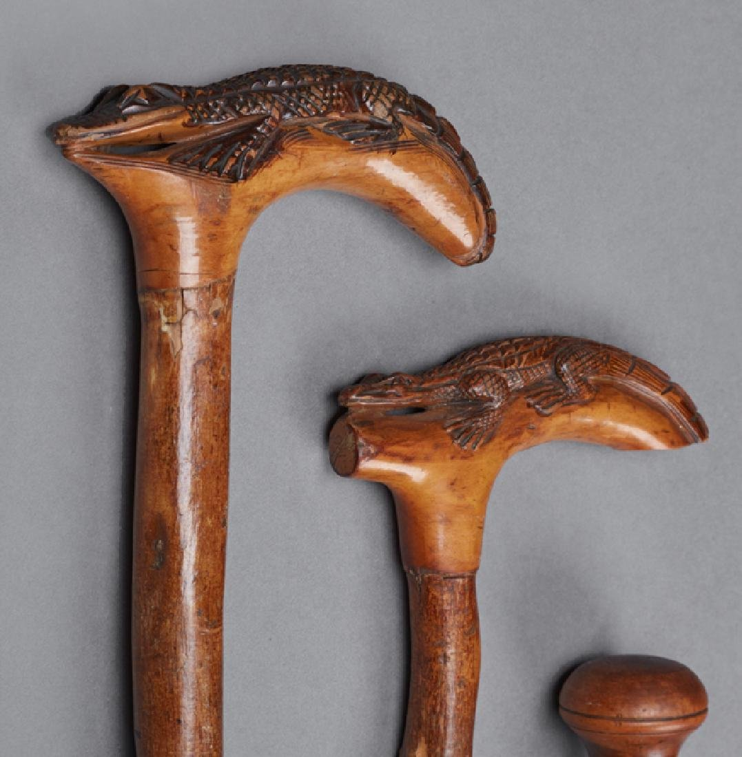 Group of Five Carved Wood Folk Art Canes, one dated