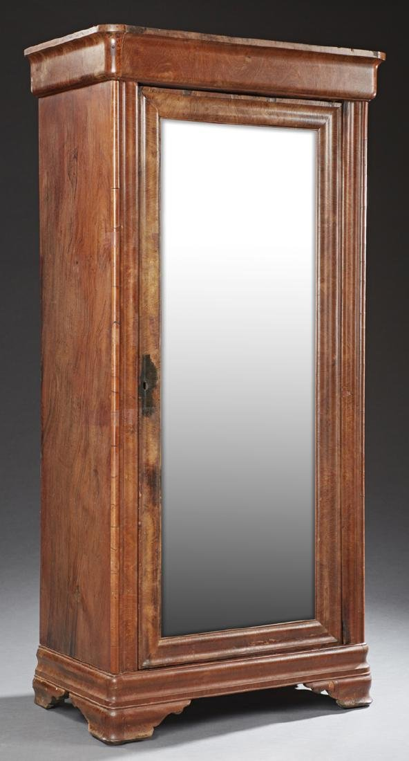 Ameircan Carved Mahogany Armoire, 19th c., the rounded