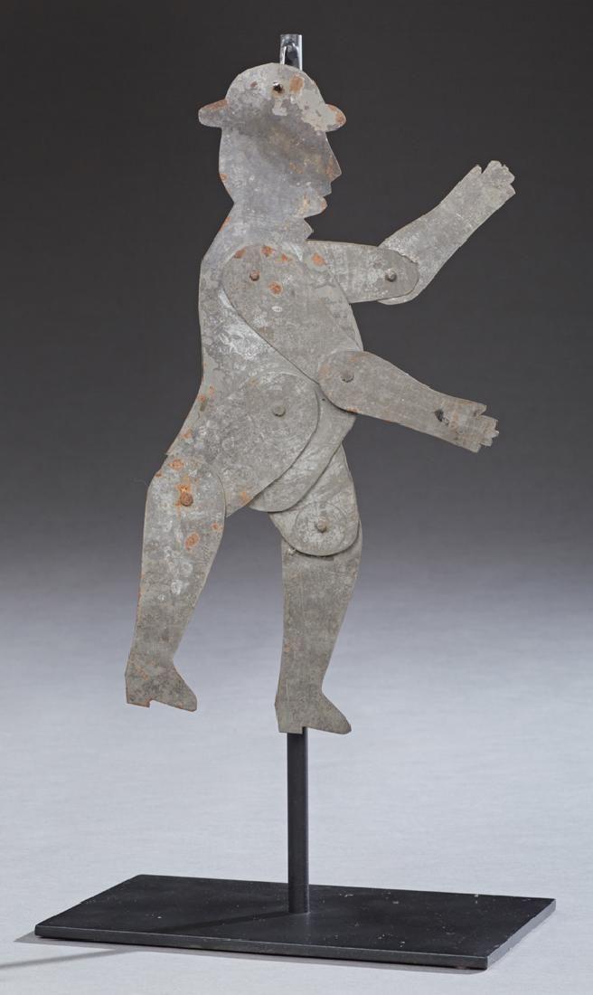 Folk Art Articulated Tin Man, early 20th c., on an iron