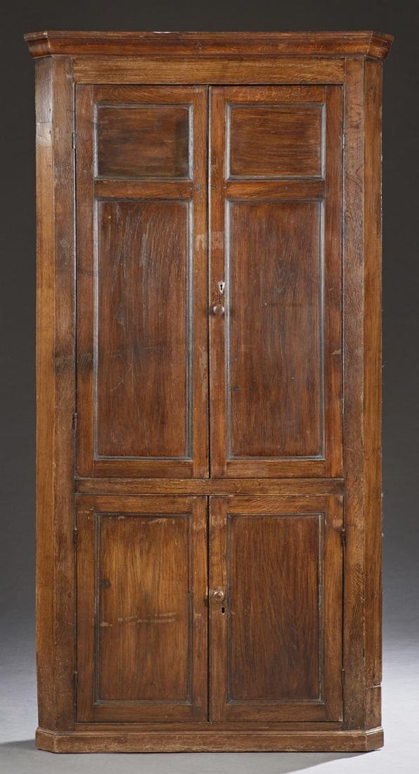 English Carved Oak Corner Cabinet, 19th c., the stepped