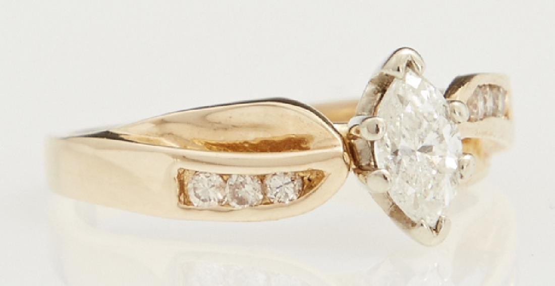 14K Yellow Gold Dinner Ring, with a marquise diamond