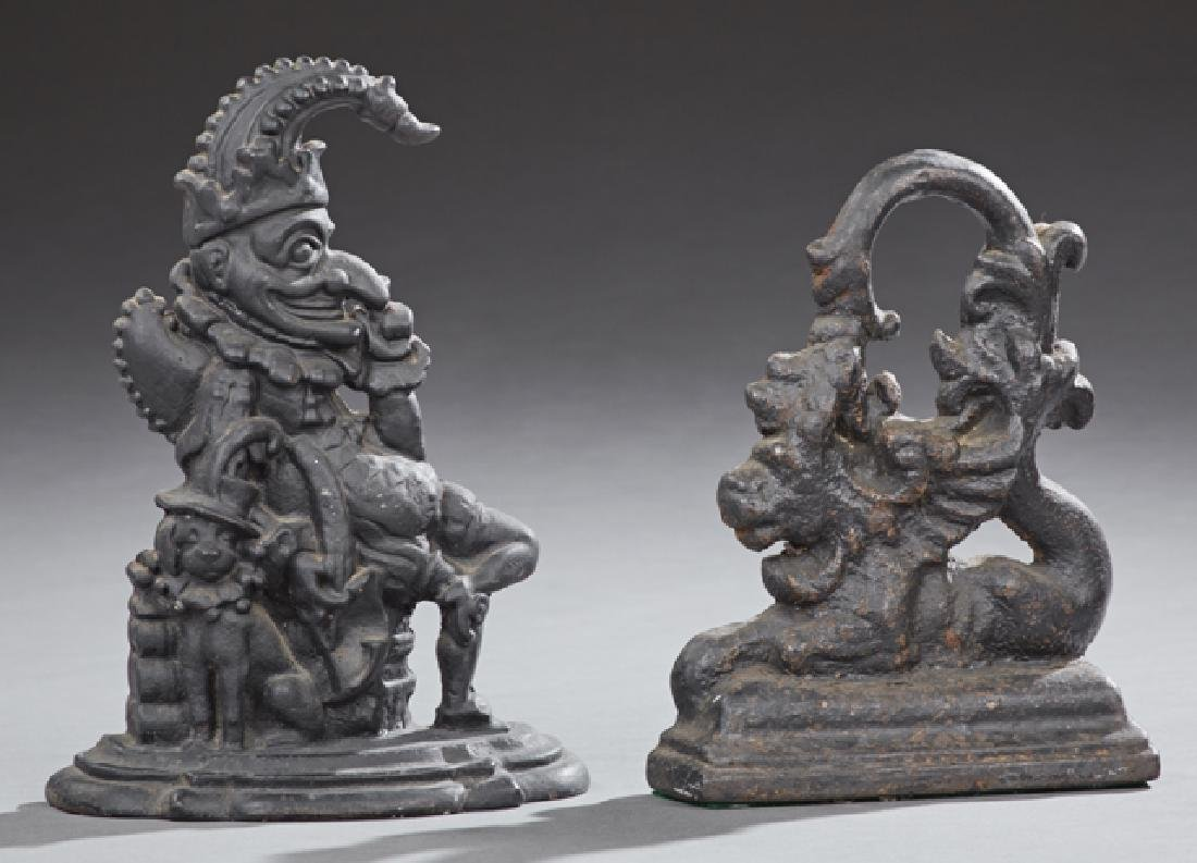 Two Cast Iron Doorstops, c. 1880, one of Punch and his