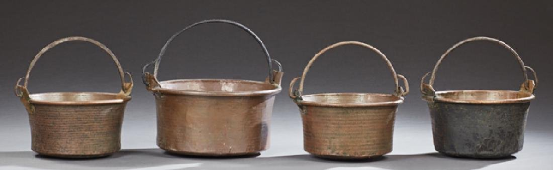 Group of Four Large French Copper Cauldrons, 19th c., w