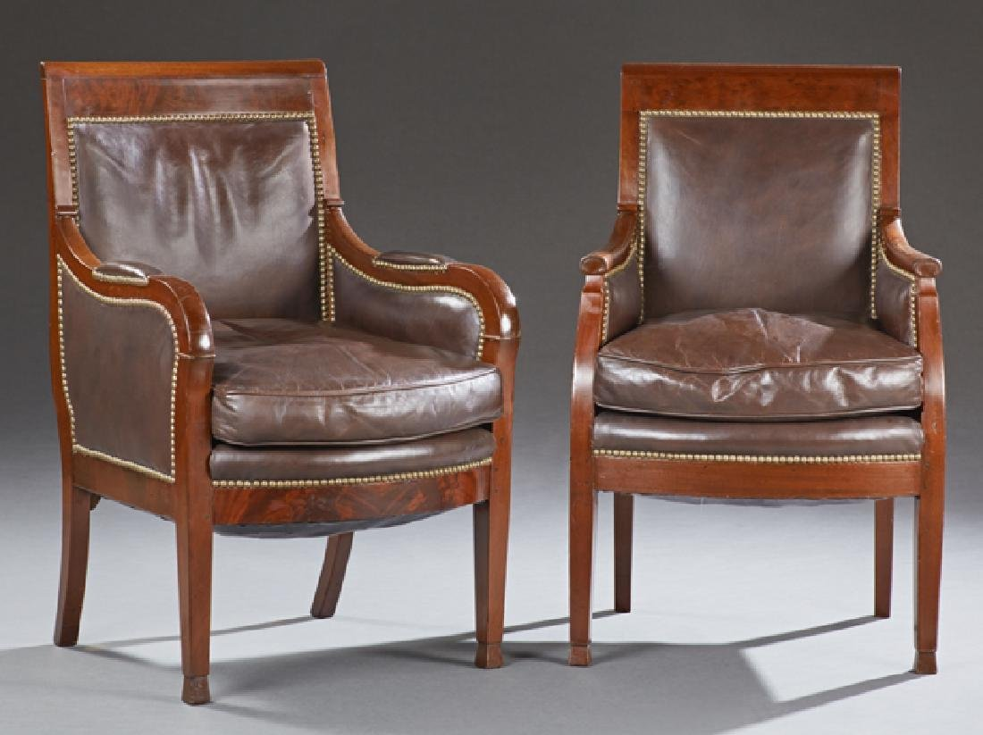 Near Pair of Carved Mahogany Leather Bergeres, c. 1840,