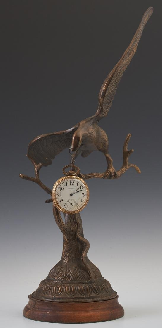 Bronze Eagle Pocket Watch Holder, 20th c., on a stepped