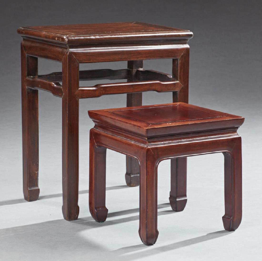 Nest of Two Chinese Carved Mahogany Tables, 20th c., on