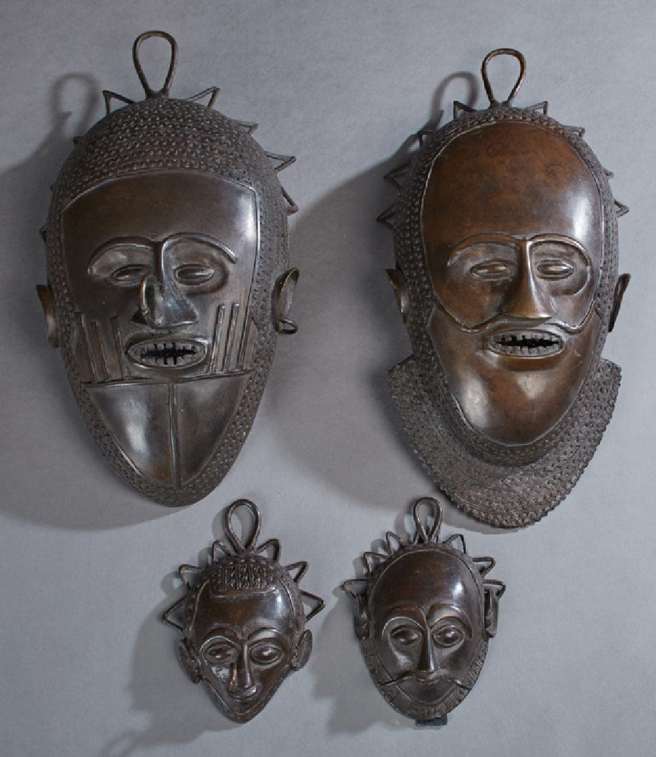 Four Benin Bronze Masks, 20th c., two large and two