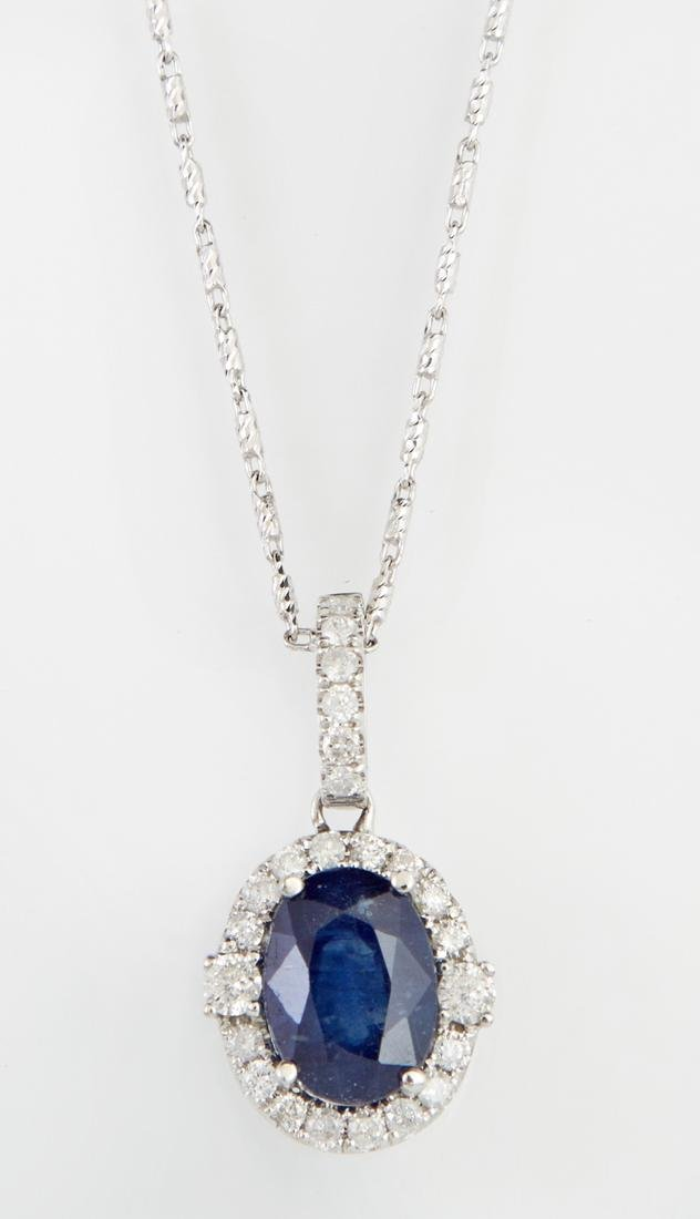 14K White Gold Pendant, with an oval 4.07 carat blue