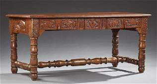 French Louis XIII Style Carved Oak Desk, 19th c., the