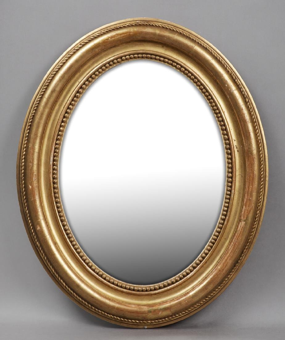 French Louis Philippe Gold Leaf and Gesso Oval Mirror,