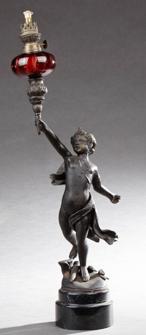 American Patinated Iron Oil Lamp, late 19th c., with a