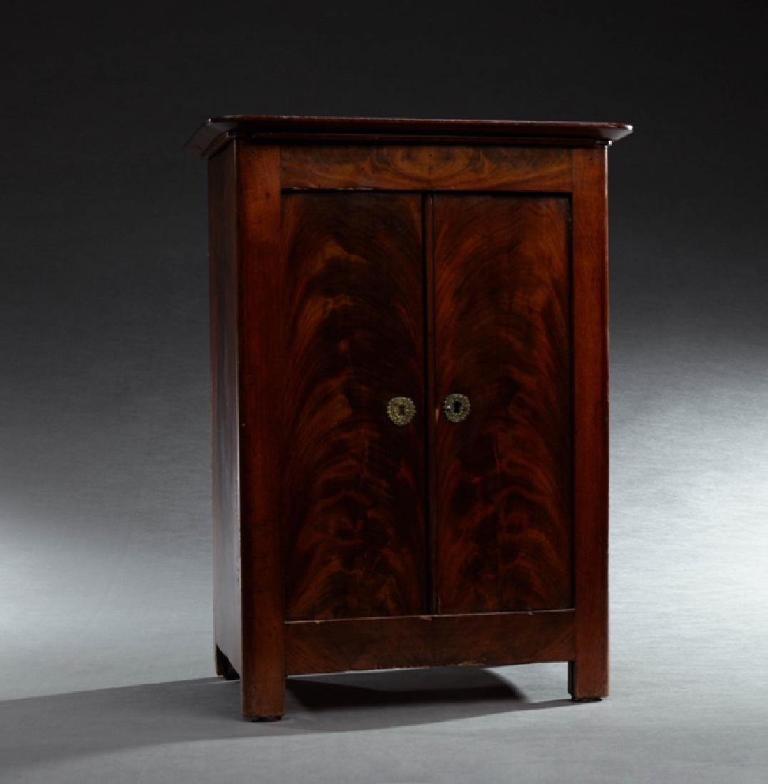 Carved Mahogany Dollhouse Armoire, 19th c., the rounded