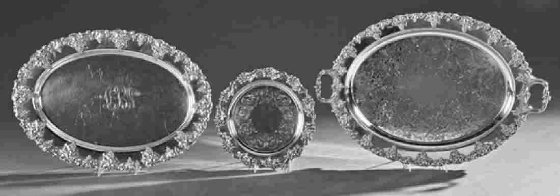 Group of Three Silverplated Serving Trays, with relief