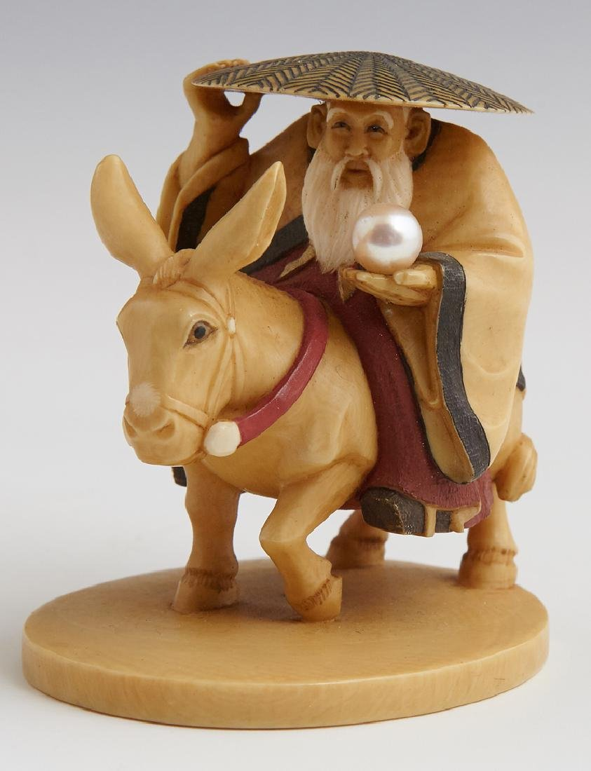 Carved and Stained Bone Okimono, 20th c., by Shuko, of