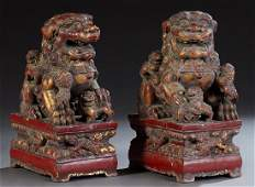 Pair of Carved Giltwood and Red Paint Decorated Foo Dog
