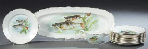 Fourteen Piece French Ceramic Fish Set, 20th c., by